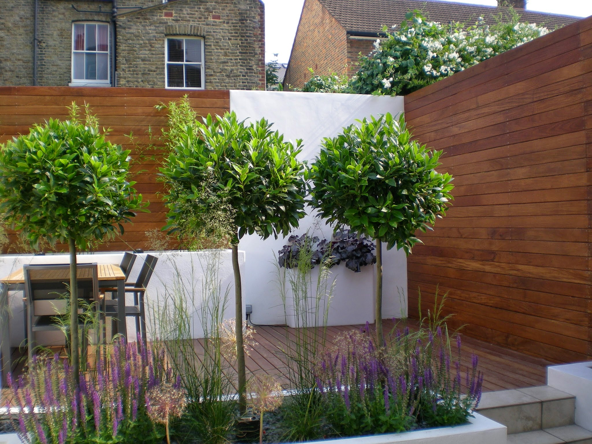 Modern Garden Design contemporary style rendered walls and raised beds The Design Materials